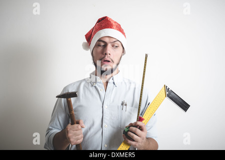 bricolage christmas stylish young man on white background - Stock Photo
