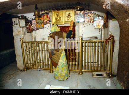 Amritsar India Langa Wali Devi - Woman Worshipping - Small Shrine - Stock Photo