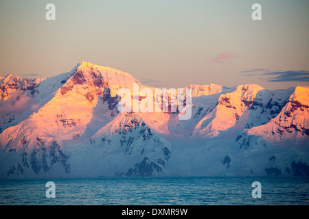 Evening light over mountains from the Gerlache Strait separating the Palmer Archipelago from the Antarctic Peninsular - Stock Photo