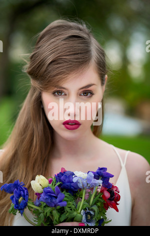 Girl with wild flowers bouquet - Stock Photo