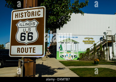 Sign for the Historic Route 66  and a mural for the Village of Gardner  in Gardner, Illinois, a town along the Lincoln - Stock Photo