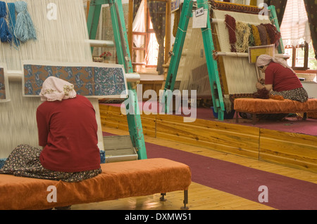 ASIA, Turkey, Cappadocia, Avanos, women at work in carpet weaving factory - Stock Photo