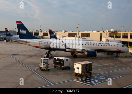 US Airways Embraer ERJ 190-100 IGW jet parked at a gate, Philadelphia International Airport, Pennsylvania, United - Stock Photo