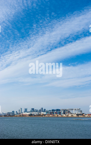 View of the Conley Terminal and Boston skyline from the Pleasure Bay in South Boston. - Stock Photo