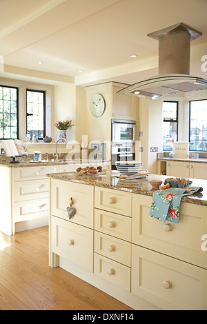 Large Modern Cream Country Kitchen With Baking Preparation Going On In A Home In The Uk