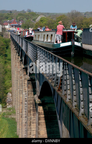 Narrowboats on Pontcysyllte Aqueduct which carries the Llangollen Canal over the river Dee in north Wales - Stock Photo