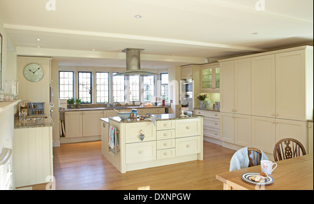 A large modern cream country kitchen in a home in the UK.