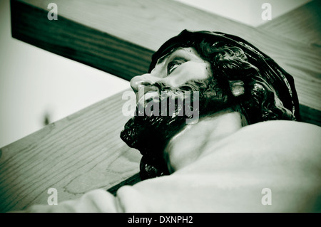 a figure of Jesus Christ carrying the Holy Cross in black and white - Stock Photo