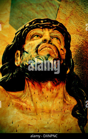 a figure of Jesus Christ in the Holy Cross, with a retro effect - Stock Photo