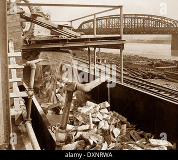 Loading pig iron into railroad cars at steelworks Pittsburg Pennsylvania USA early 1900s - Stock Photo