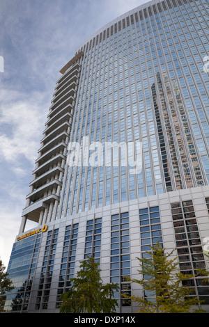 Germany, Hesse, Frankfurt, Messeturm reflecting in office building - Stock Photo