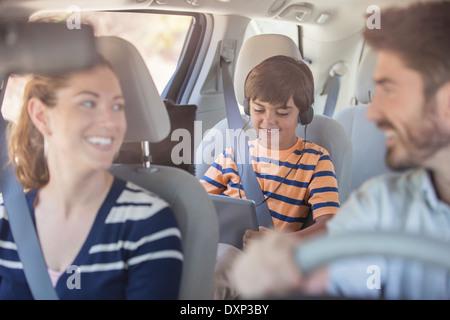 Happy family inside car - Stock Photo