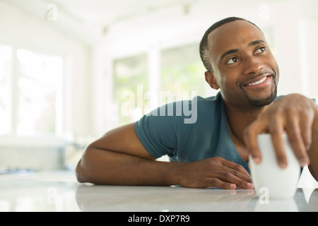 Pensive man drinking coffee - Stock Photo