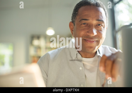 Close up portrait of smiling senior man - Stock Photo