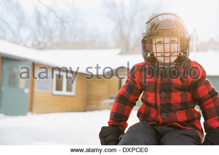 Portrait of smiling boy wearing helmet - Stock Photo