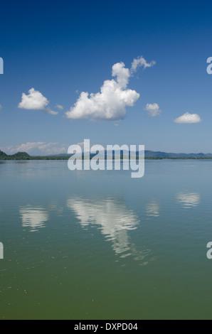 Guatemala, Department of Izabal, Rio Dulce River, El Golfete lake. Calm lake with cloud reflections. - Stock Photo