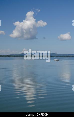 Guatemala, Department of Izabal, Rio Dulce River, El Golfete lake. Sailboat navigating the calm lake. - Stock Photo