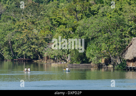 Guatemala, Department of Izabal, near Livingston, Rio Dulce (Sweet Water River). Traditional fishing boat on the - Stock Photo