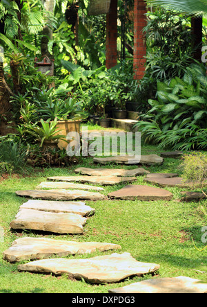 Natural stone path in a natural garden - Stock Photo