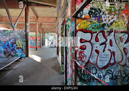 Berlin, Germany, smeared walls in the ruins of Abhoerstation the U.S. Army on the Teufelsberg - Stock Photo