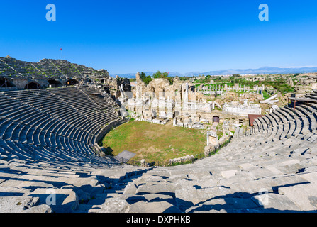 View over the ruins of ancient Side from the Theatre, Pamphylia, Antalya Province, Turkey - Stock Photo