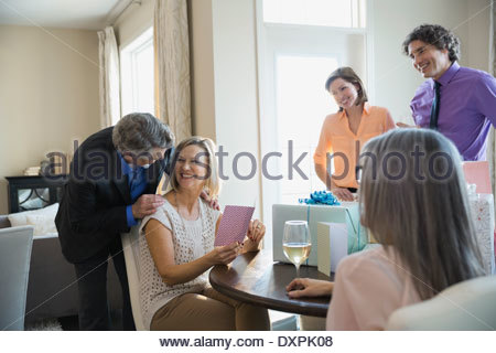 Woman with gift card at birthday party - Stock Photo