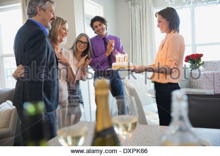 Family and friends celebrating birthday at home - Stock Photo