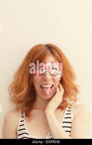 Superhero girl wearing mask with strawberries - Stock Photo