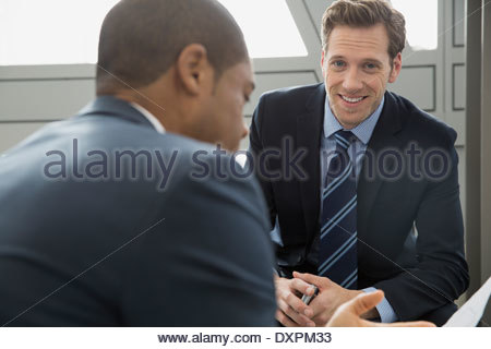 Portrait of confident businessman in meeting - Stock Photo