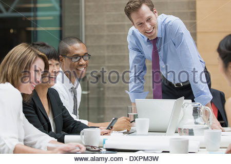 Happy business people talking in conference room meeting - Stock Photo