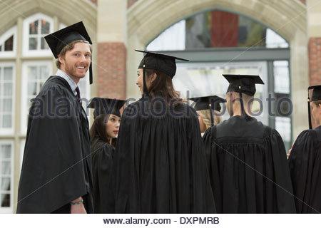Portrait of happy college graduate - Stock Photo