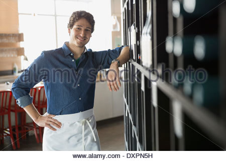 Portrait of confident sommelier in wine store - Stock Photo