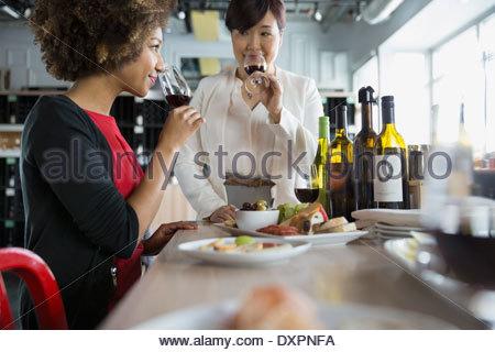 Women wine tasting in store - Stock Photo