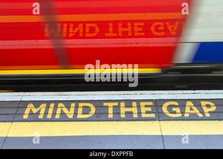 Mind the gap warning at station on the London Underground, England, UK - Stock Photo