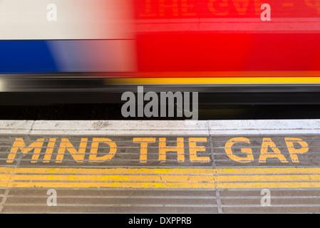 Mind the gap on London Underground, UK - Stock Photo