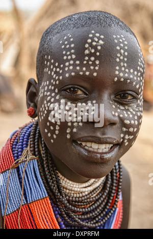 Karo girl with face paint in Kolcho on the Omo River, Ethiopia - Stock Photo