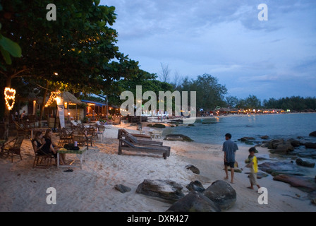 Sihanoukville beach. At dusk becomes the meeting place to savor a good beer. Sihanoukville (Krong Preah Seihanu), - Stock Photo