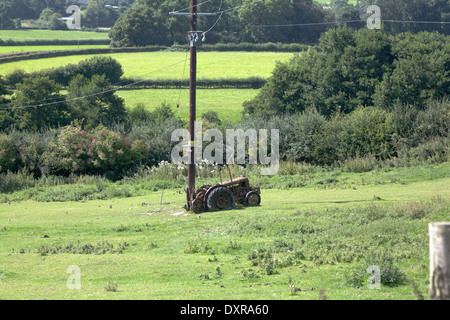 Abandoned and rusting tractor on a farm River Teme Valley near Knighton  from The Offa's Dyke Path Shropshire England - Stock Photo