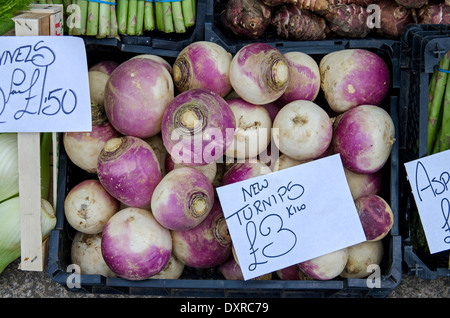 New turnips for sale on an outdoor market stall in the Grassmarket, Edinburgh. - Stock Photo