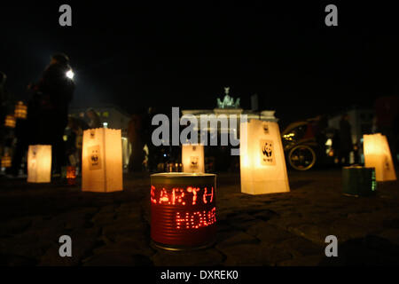 Berlin. 29th Mar, 2014. Photo taken on March 29, 2014 shows the candles in front of the Brandenburg Gate during - Stock Photo