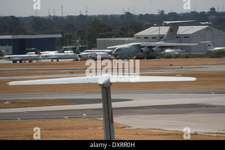 Perth. 30th Mar, 2014. A Chinese searching aircraft returns to Perth International Airport in Australia, March 30, - Stock Photo