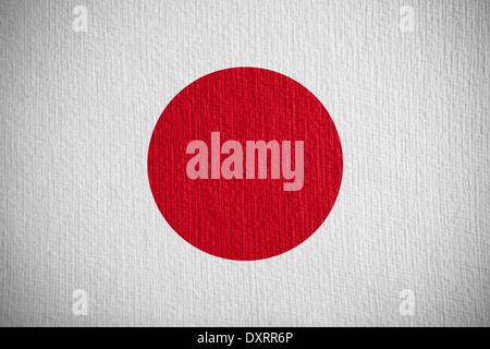 flag of Japan or Japanese banner on paper background - Stock Photo
