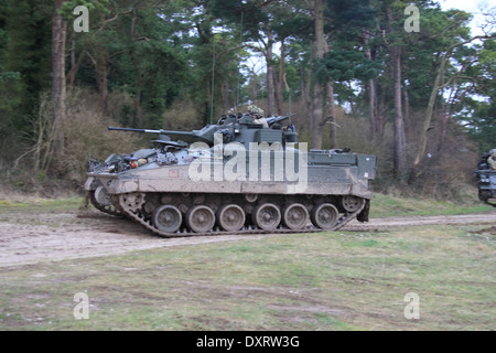 FV510 Warrior IFV traveling over rough terrain on Salisbury Plain Training Area during an exercise - Stock Photo