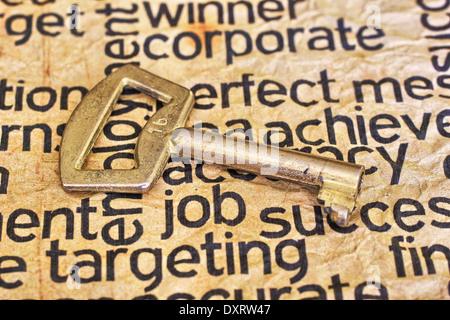 Golden key on job text - Stock Photo