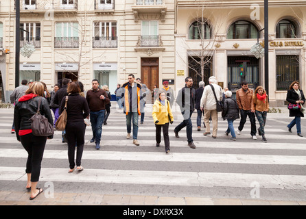 Pedestrians crossing a street in Spain; - Spanish people in Granada, Andalusia, Spain Europe - Stock Photo