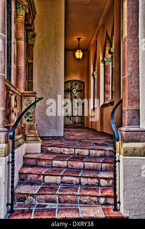 External corridor leading to wooden door, Ca' d'Zan Mansion, Ringling Museum, Sarasota, Florida - Stock Photo