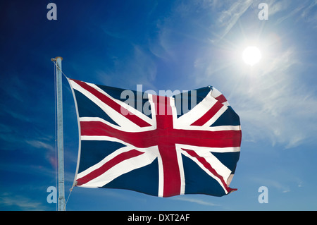 Union Jack flying high, against blue sky with copy space - Stock Photo