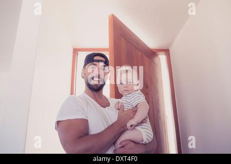 Boy opening door, smiling Stock Photo, Royalty Free Image ...