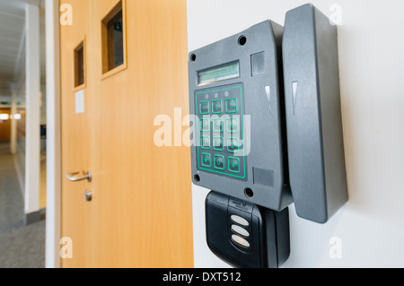 Card reader at an office door to allow access - Stock Photo