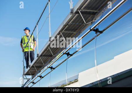 Worker on platform above stainless steel milk tanker - Stock Photo